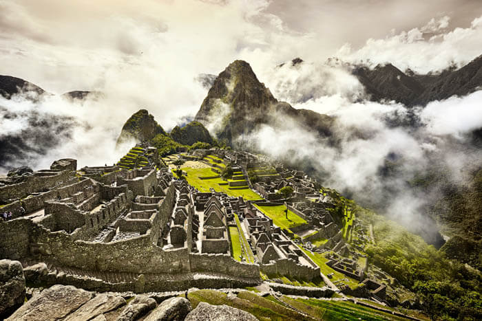 Dramatic View of Machu Picchu shrouded in clouds